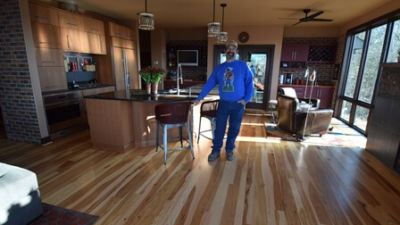 The Sandhages graciously invited John into their home to see their floor after installation.